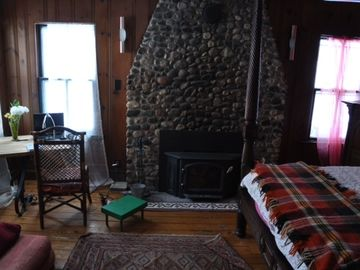 Cozy masterbed room, view of fireplace and corner table