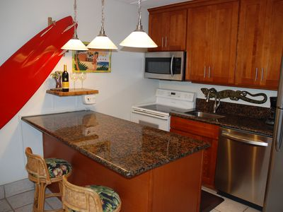 Kitchen with granite countertops and new cabinets.