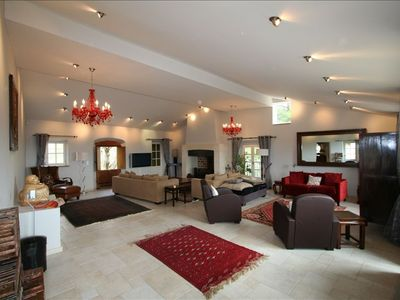 Living room with 2 separate seating areas, huge fireplace, fabulous views
