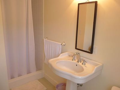 New private back bedroom bath with large walk-in shower.