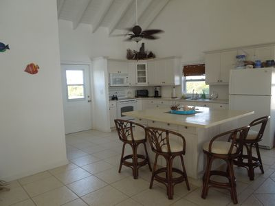 Open kitchen with large island for food prep and casual dining.