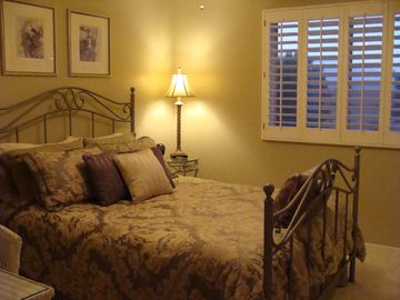 Guest queen bedroom with views of the foothills and beautiful sunsets