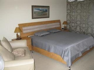 Boardwalk condo photo - .Private master suite with ocean view. sliders opening to deck facing the ocean.