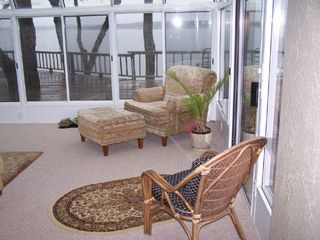 Langley house photo - Additional seating in sunroom overlooking deck and lake
