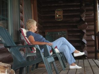 Ely cabin photo - Relazing on the Wildloon porch watching the sunset & hummmingbirds
