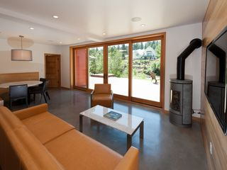 Truckee house photo - Indoor Outdoor clean and modern feel to the living room. Dooropen onto outdoor