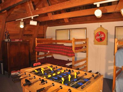 Loft area/sleeping area that has foosball, darts, and plenty of board games.