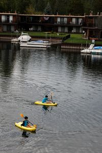 Tahoe Keys house rental - Kayaking in backyard. 3 kid-size and a 2-person inflatable kayaks are in garage.