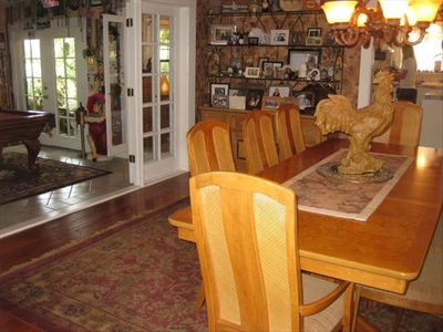 Beautiful burl dining room table off of the gameroom french doors and kitchen