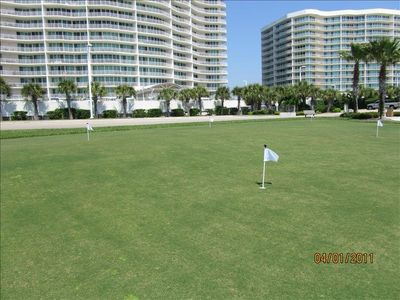 Caribe's professional grass putting green surrounds the signature fountain.