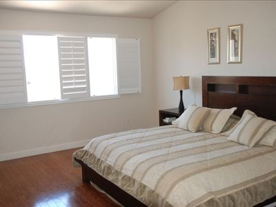 Master Bedroom with King size bed + TV.