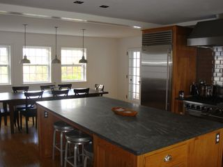 Woodstock house photo - Kitchen with Subzero fridge, Five Star oven and range, barn wood dining table.