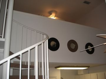The view of the loft from the main floor. Kids LOVE the spiral staircase!