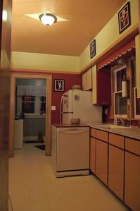 Bigfork farmhouse rental - A country kitchen with dishwasher, range and oven, refrigerator, blender....
