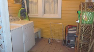 Indian Rocks Beach cottage rental - Shared laundry area/ beach equipment area (chairs, cart, umbrellas)