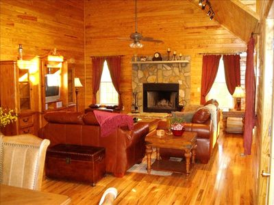 Living Room with stone fireplace, 25' vaulted ceilings
