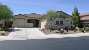 Maricopa house rental - Shaded north facing front patio and a double attached garage for your use