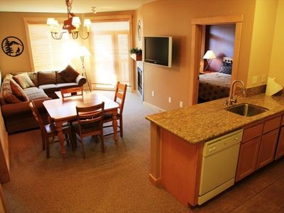 Granite countertops throughout and dining area with seating for 6