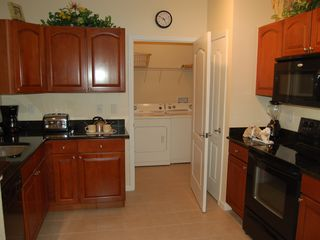 Cane Island condo photo - Condominium Kitchen and Laundry Room - View 2