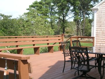 Large deck overlooking private backyard