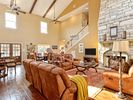 Great living room with gas fireplace and large dining table.