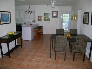 Vieques Island villa photo - Dining area with kitchen at rear left