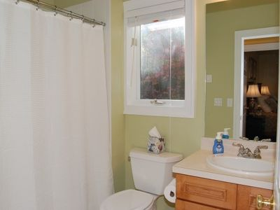 Main Level Green Room Ensuite Bath with Heated Tile Floors