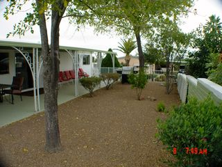 Green Valley mobile home photo - Spacious back yard with fencing for your pet to enjoy and ample outdoor seating