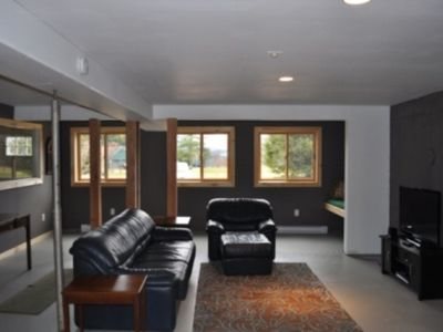 Family Room, ground level, with separate mudroom entrance vestibule.