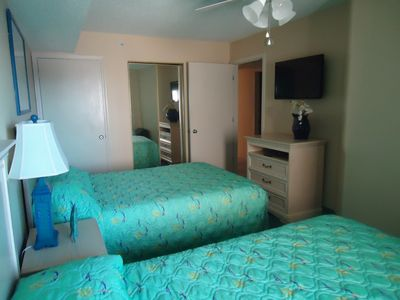 View of guest bedroom with TV.