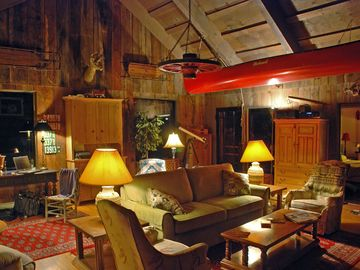 LR opposite the fireplace. Rough-hewn walls & ceiling for cozy evenings.