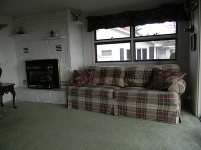 Living room has fireplace.
