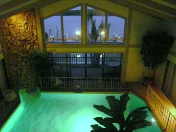 Beautiful view of indoor pool & outdoors from our loft area at nite