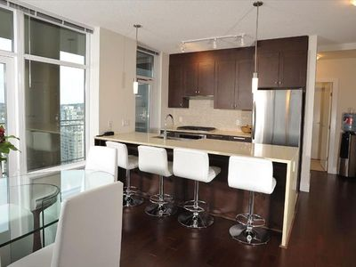 Vancouver condo rental - Gourmet kitchen with gas stove, convection oven, oversized countertops, and more
