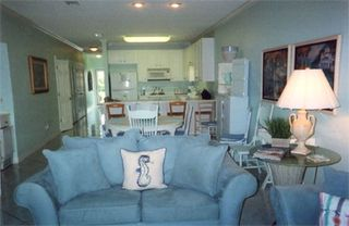 Orange Beach condo photo - Living room looking toward dining area and kitchen
