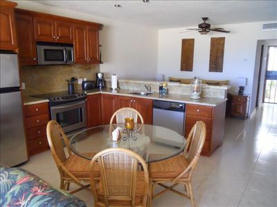 Large kitchen, stainless steel appliances, granite counters, fully equipped.