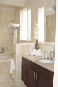 modern marble bathroom with heated floors and jetted tub