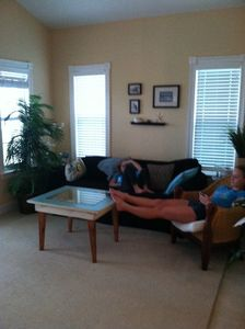 Comfy family room decorated Beach Modern..