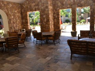 Breezeway area that overlooks main pool area... - Bella Piazza condo vacation rental photo