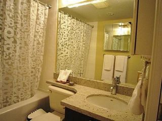 Vancouver townhome photo - Master ensuite bath with a tub/shower, updated vanity/sink/toilet.