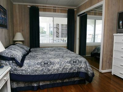1 of 4 upstairs bedrooms with ocean view, king size bed  & adjoining bathroom
