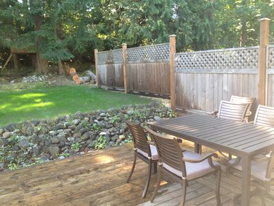 DECK AND YARD, ENJOY A BARBEQUE DINNER AND RELAX WITH A GLASS OF WINE.