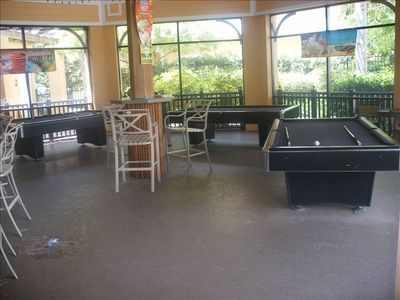 Pool tables in Tradewinds Restaurant and Bar overlooking pool and lake.