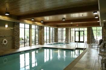 Resort includes indoor hot tub and pool, outdoor hot tub, fitness & arcade rooms