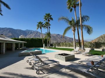 Palm Springs estate rental - Gorgeous and secluded pool area with fire pit and lounges.