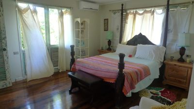 Bedroom with queen bed, a/c, bathroom, sweet serenity