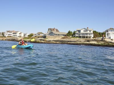Mom kayaking in front of house