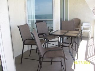 Cherry Grove Beach condo photo - View of the ocean from the living area with the solar shades down