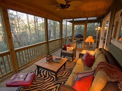Experience beautiful sunrises and sunsets from the screened porch.