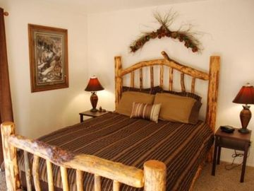 Bedroom with Comfortable Lodge Pole Queen Bed and Memory Form Topper - Unit #301